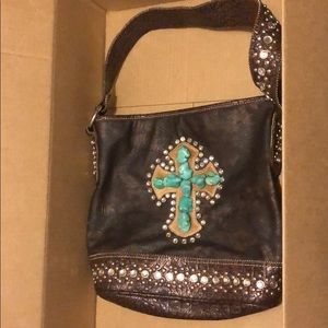Purse with stone cross and lots of bling